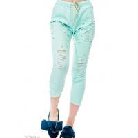 Мятные джинсовые брюки с прорезями и бусинками