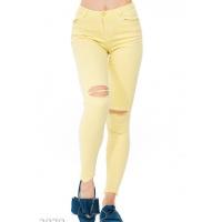 Желтые узкие джинсы с прорезями