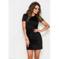 Черное облегающее платье из эко-замши с диагональным воланом