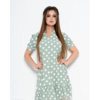 Зеленое платье в горошек с воланом