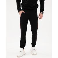 Черные трикотажные штаны с цветными вставками