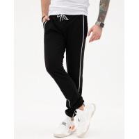 Черные трикотажные штаны с боковыми тесемками