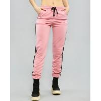 Розовые трикотажные штаны с лампасами